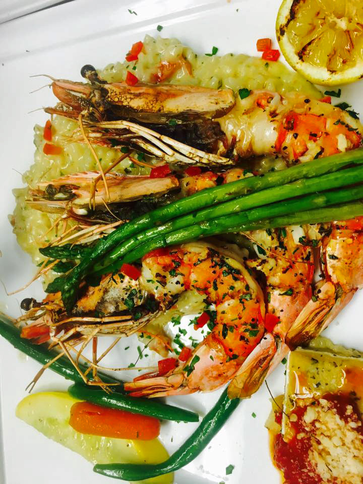 Gambas : U2 Mediterranean Shrimp, grilled with garlic and herbs , lemon risotto ,asparagus and roasted garlic pepper sauce
