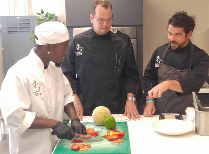 Chef Tyson and Chef Jeffrey teaching chopping techniques