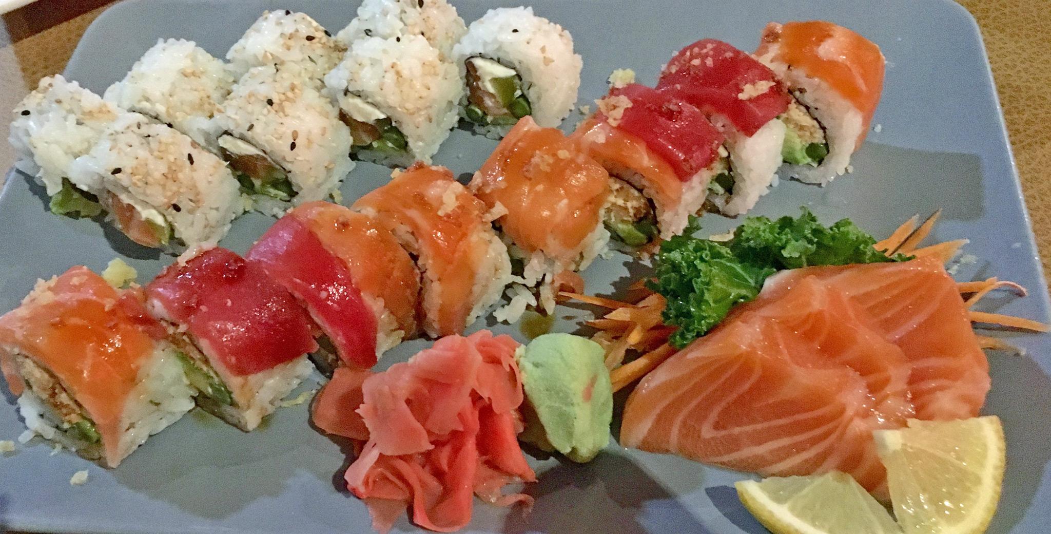 Top: THE DTSP - Salmon, pickle, cream cheese, avocado and asparagus. Middle: BOMB 'CHEL - Snow crab, avocado and asparagus roll topped with salmon, tuna, eel sauce, wasabi mayo and tempura chips. Bottom: Salmon Sashimi