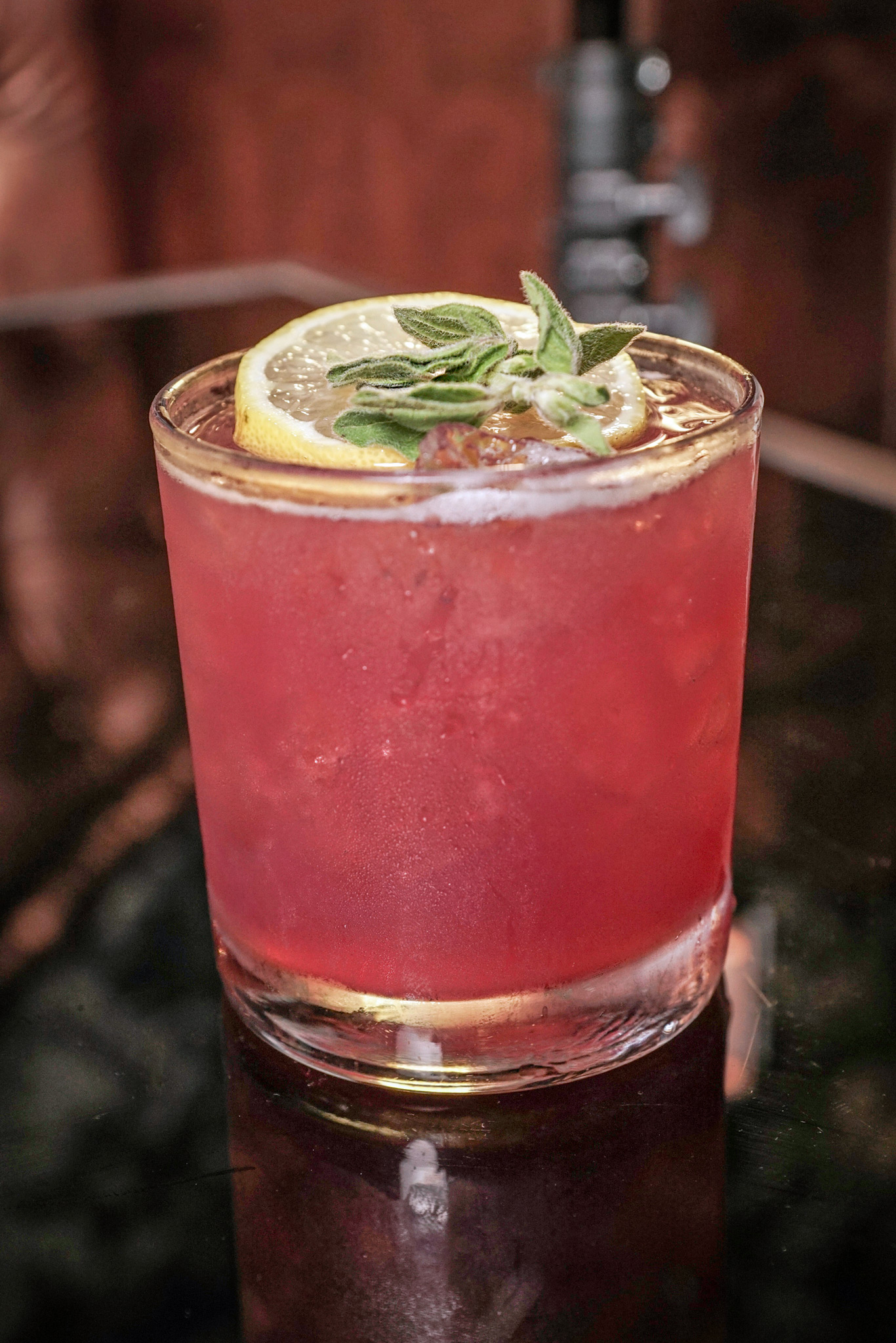 Secret Garden - grey goose vodka, mathilde cassis black currant liqueur, fresh lemon sour & sage leaves garnished with a lemon wheel & sage leaf