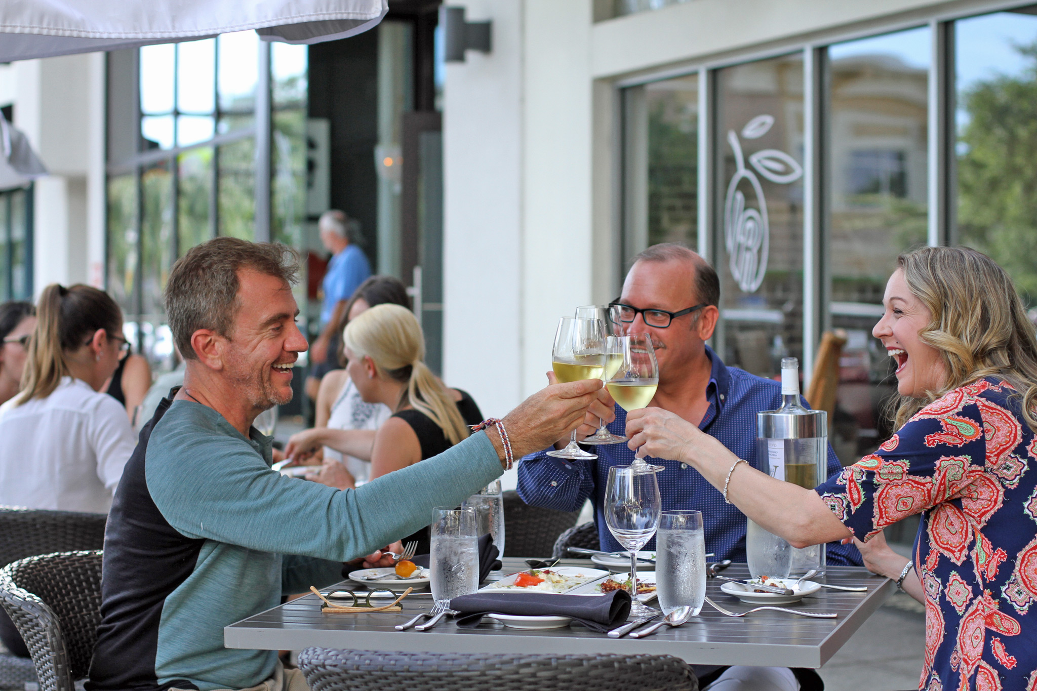 (L-R) Barry Lively, Kevin Godbee, & Lori Brown enjoying primis and outdoor seating at IL Ritorno