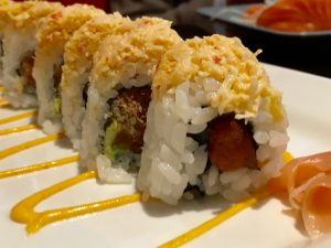 CC&T: Spicy tuna, cucumber, avocado and tempura chips rolled and topped with real snow crab meat and spicy mayo
