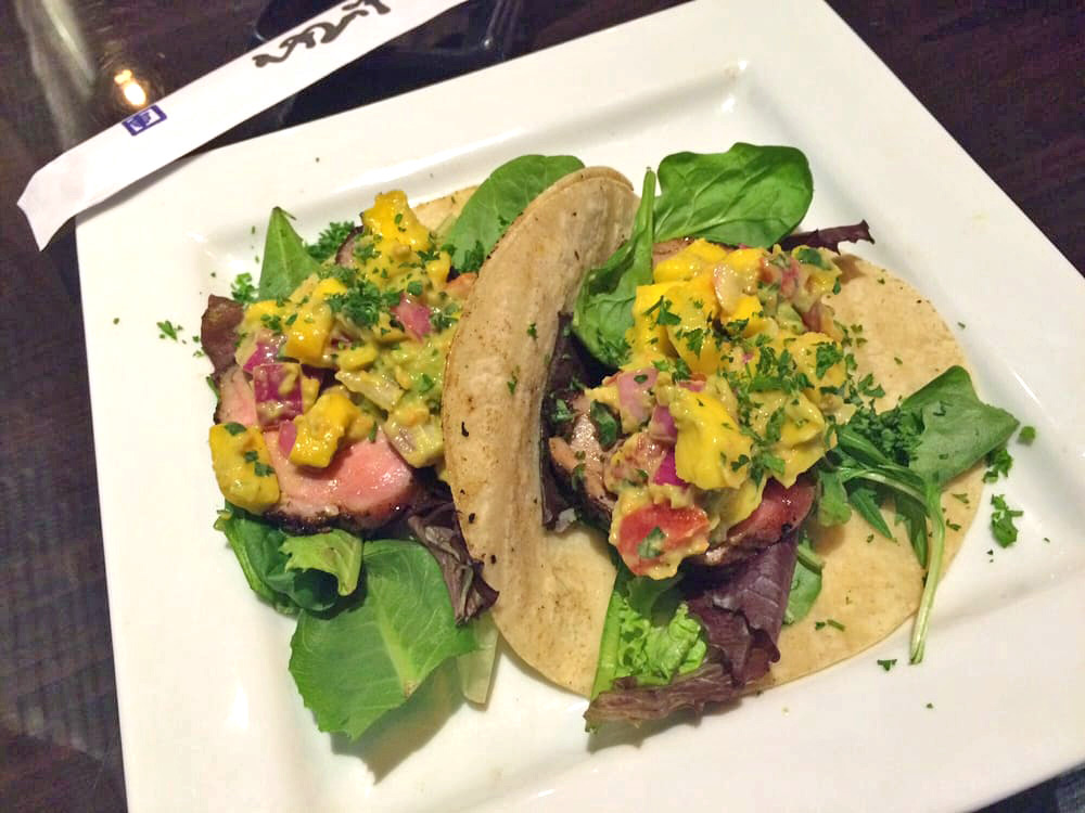 THE DONALD - Sliced, spiced and pan seared duck breast topped with mixed field greens, mango cilantro salsa fresca and ginger dressing
