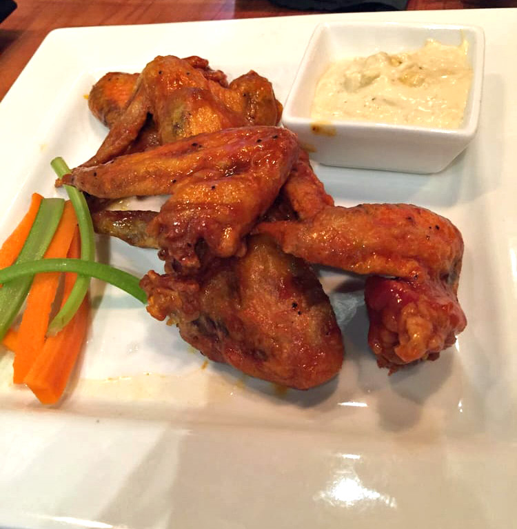AIN'T NO THANG - 6 whole chicken wings tossed in our signature Buffalo sauce