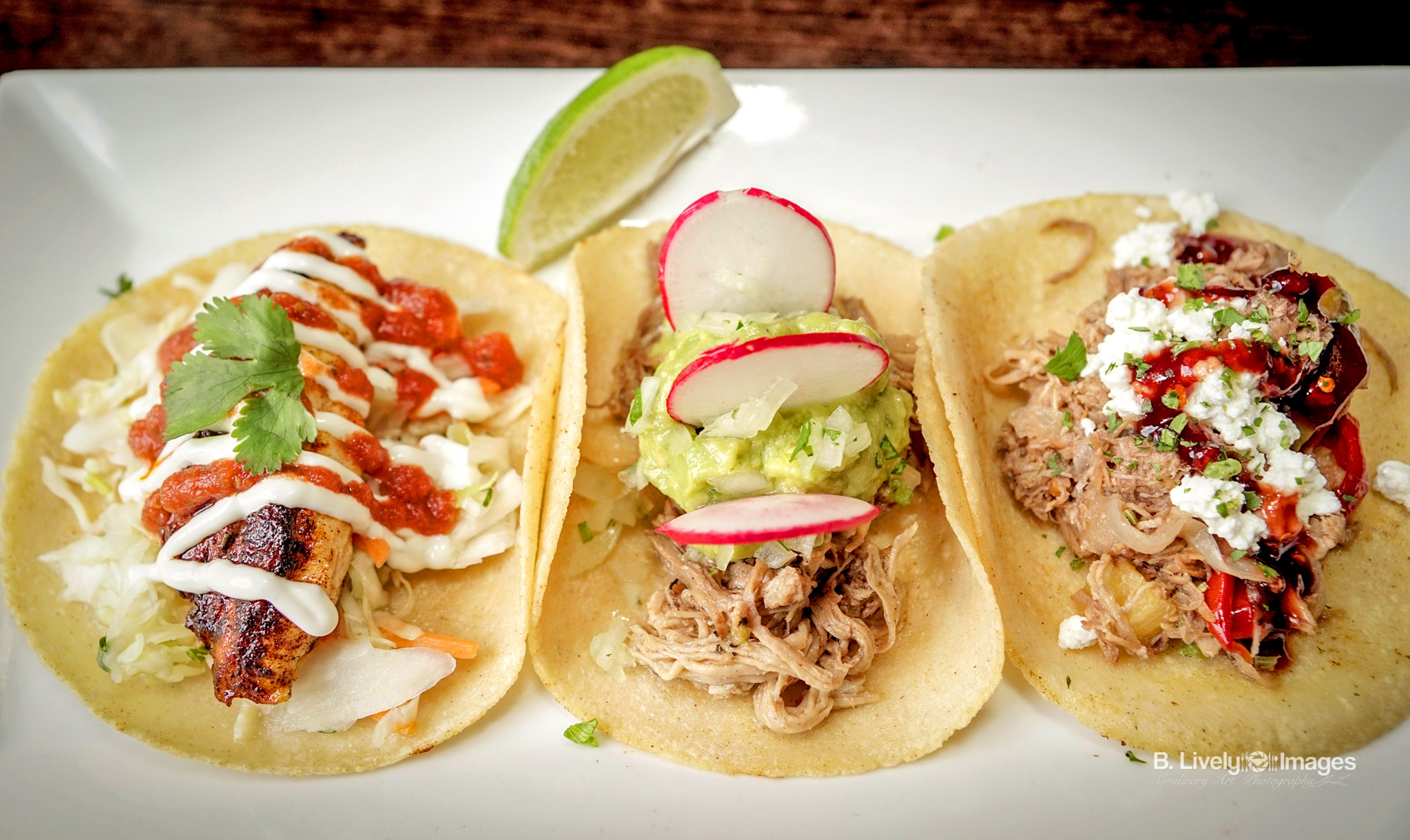 Tacos - Baja Fish - Grilled fresh fish, salsa roja, Mexican slaw and lime crema. Pulled Pork - Shredded roast pork, guacamole, cilantro onion and radish. Duck - Orange braised duck confit, grilled pineapple, goat cheese, cilantro and red chile jelly