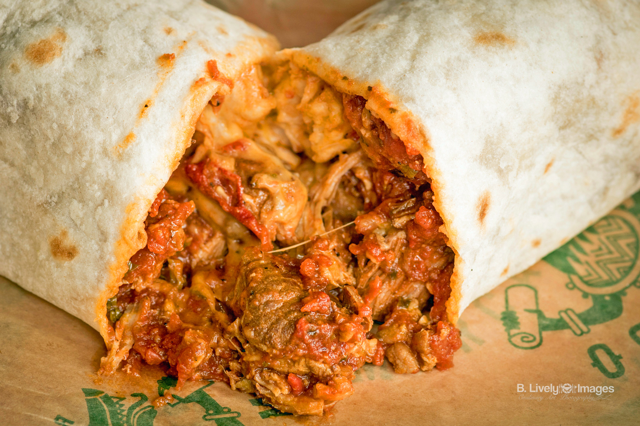 Pork Colorado Burrito - Tender Pork, Mild Tomato Chipotle Sauce, Sour Cream, Cheese