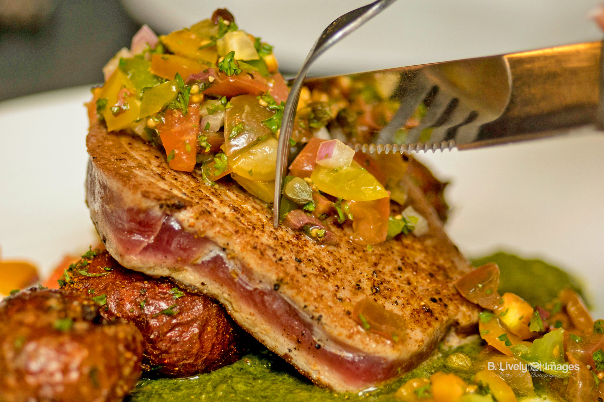 Grilled Tuna - Yellow fin tuna with crispy potatoes, heirloom tomato-olive relish and salsa verde.