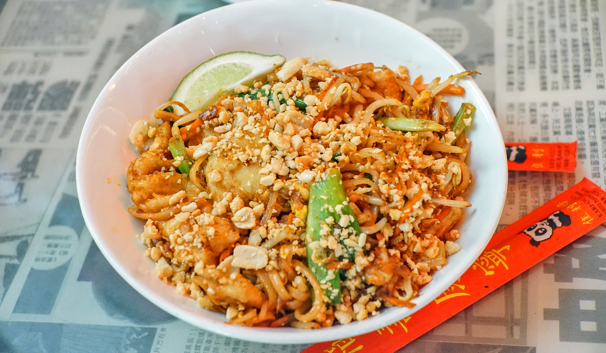 Hawkers Pad Thai - rice noodles, shrimp, chicken, eggs, bean sprouts, carrots, scallions, red chili pepper, roasted peanuts, lime