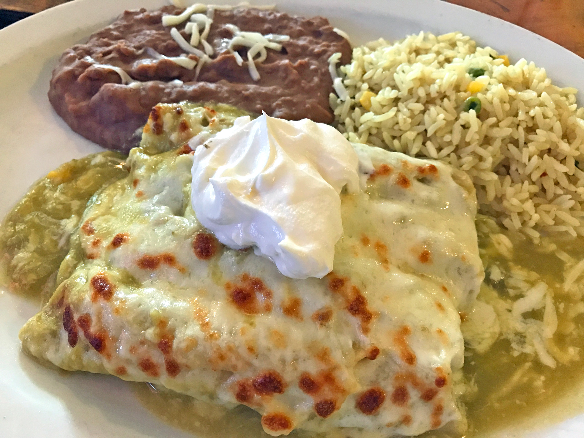 Enchilada de Pollo (Chicken) Filled with a Green Chile Tomatillo sauce