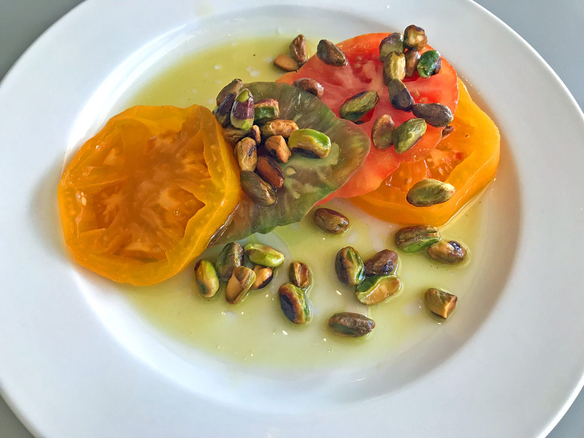 Salt & Sugar Cured Heirloom Tomatoes - fried pistachios, extra virgin olive oil, orange blossom water.