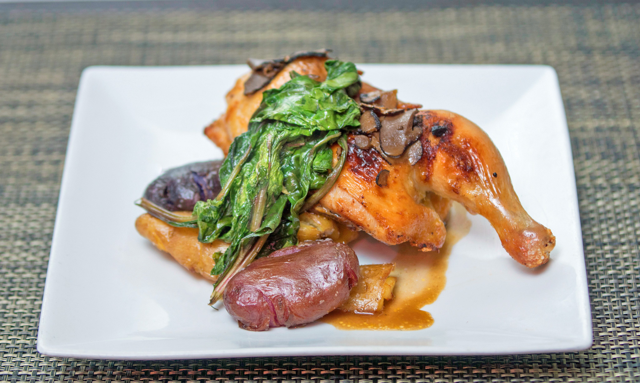 Butter and Thyme Roasted ½ Chicken - crispy fingerlings, sauté greens, truffle au jus