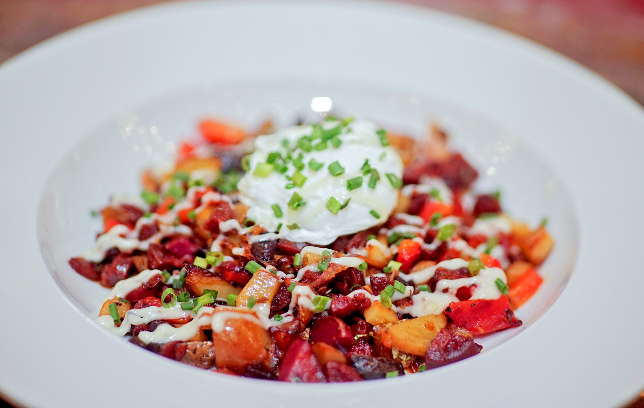 Chorizo and Fingerling Potato Hash - roasted bell peppers, crispy poached egg, garlic crema