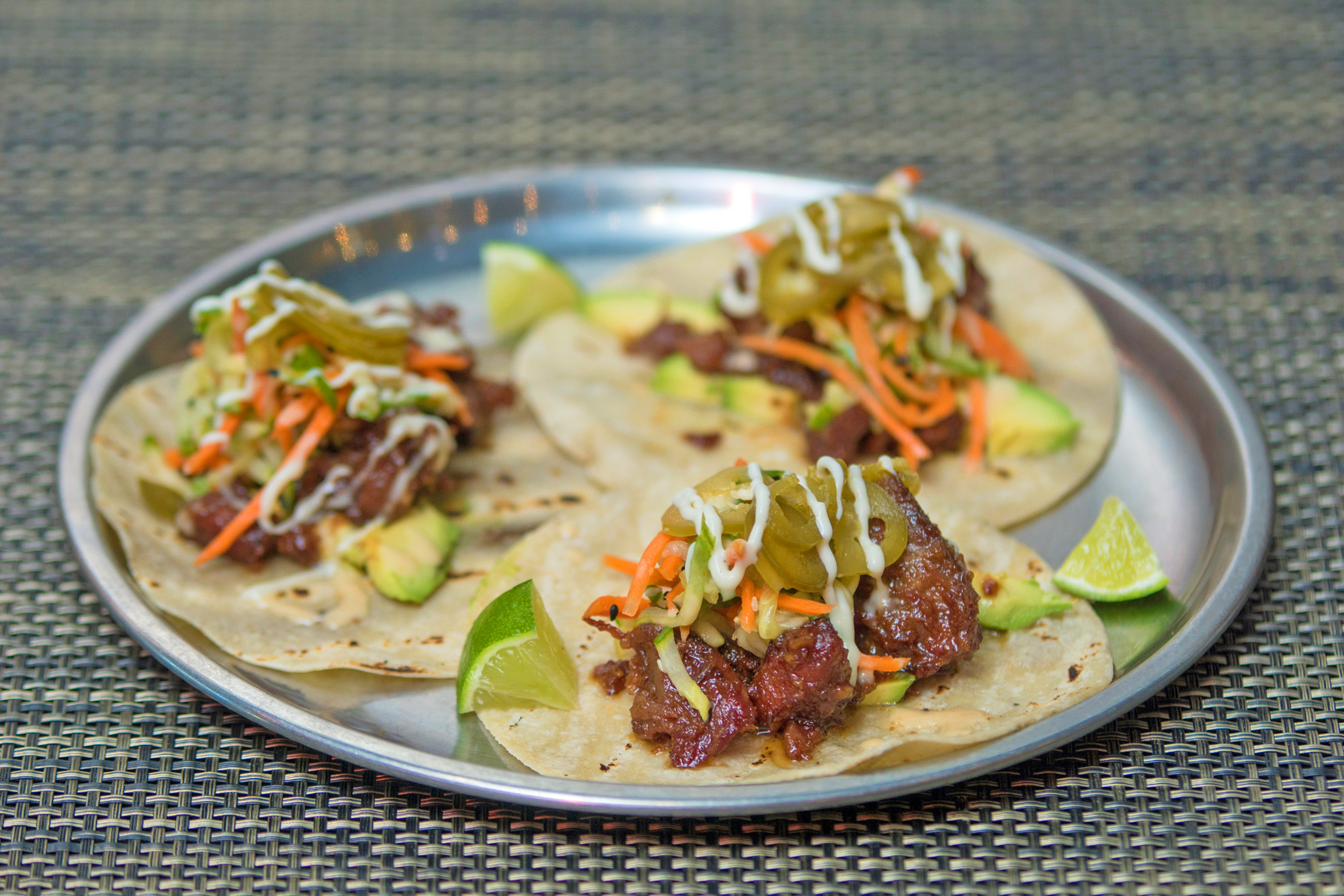 Crispy Sweet Pork Tacos - avocado, cucumber-carrot salad, blood orange mojo, garlic crema, pickled jalapeno