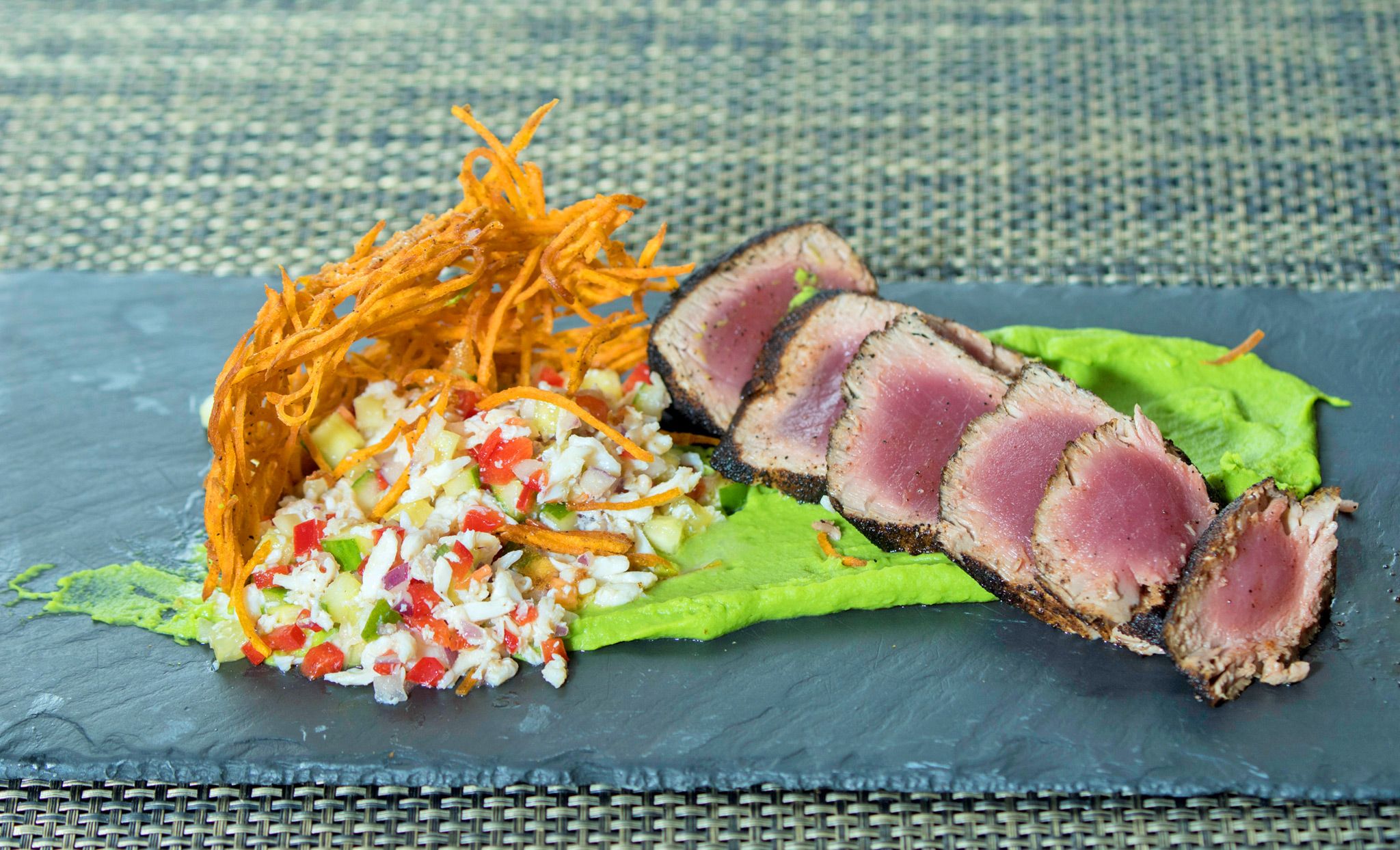 Espresso Rubbed Tuna - crab and cucumber relish, crispy sweet potatoes, sweet pea puree