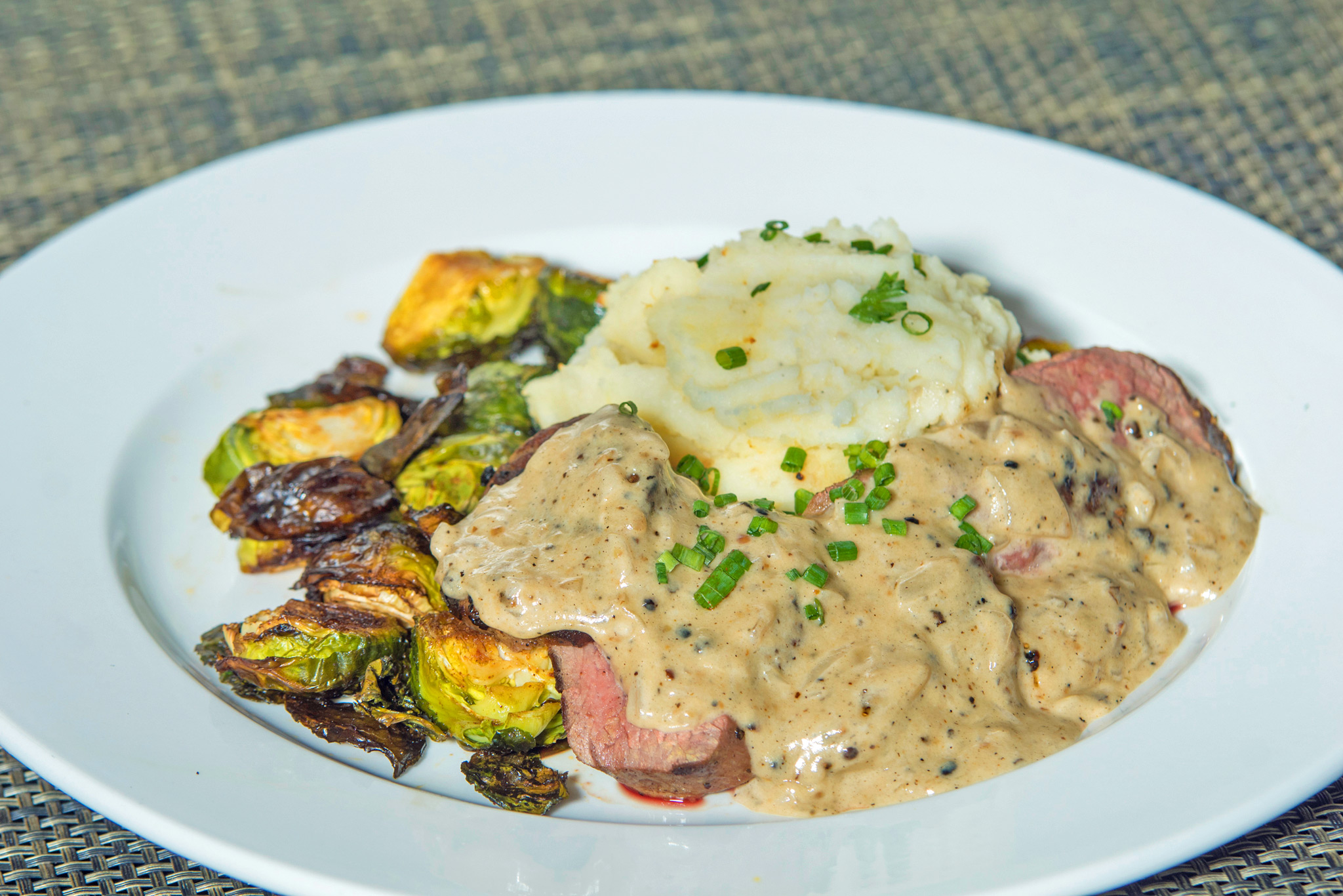 Shoulder Tender Steak - peppercorn sauce, buttermilk smashed potatoes, roast brussels sprouts