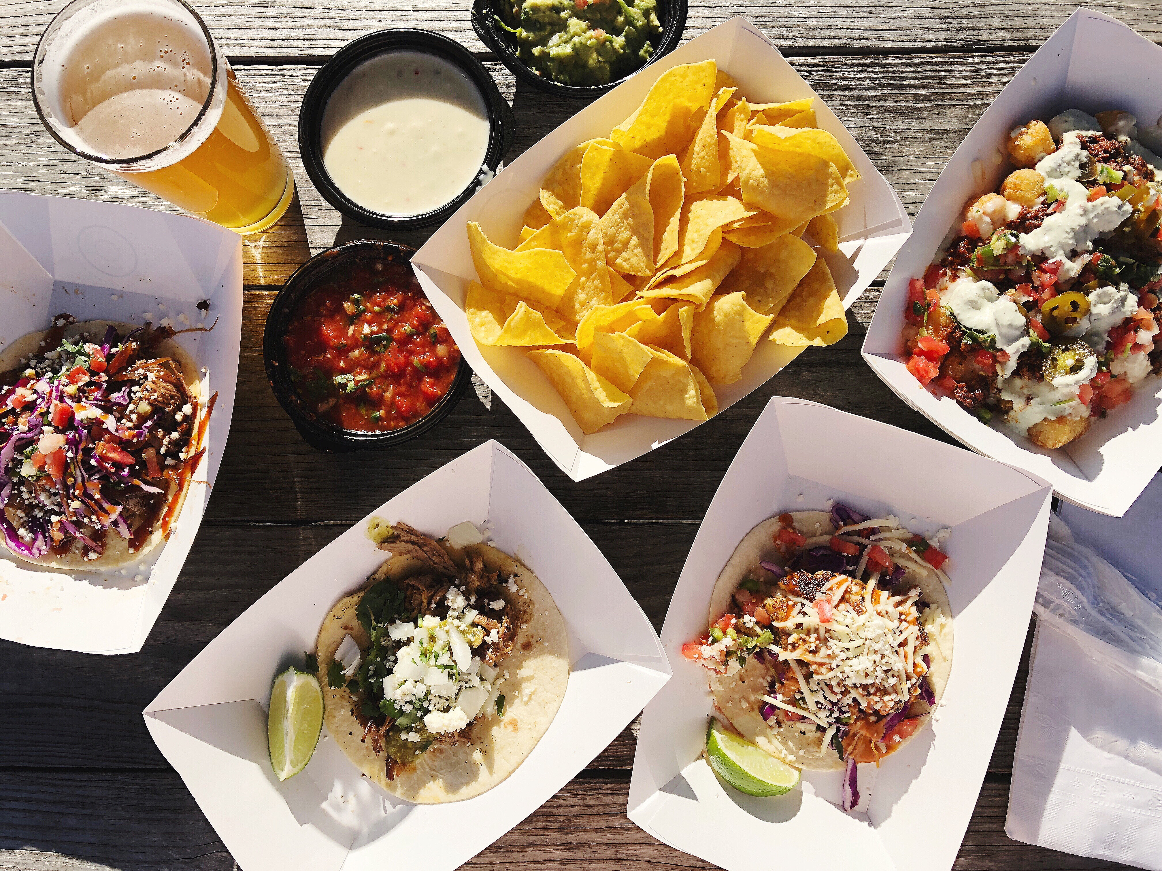 Short Rib, Pork & Fish Tacos, Tachos, a Dip Trio of Guacamole, Queso and Salsa