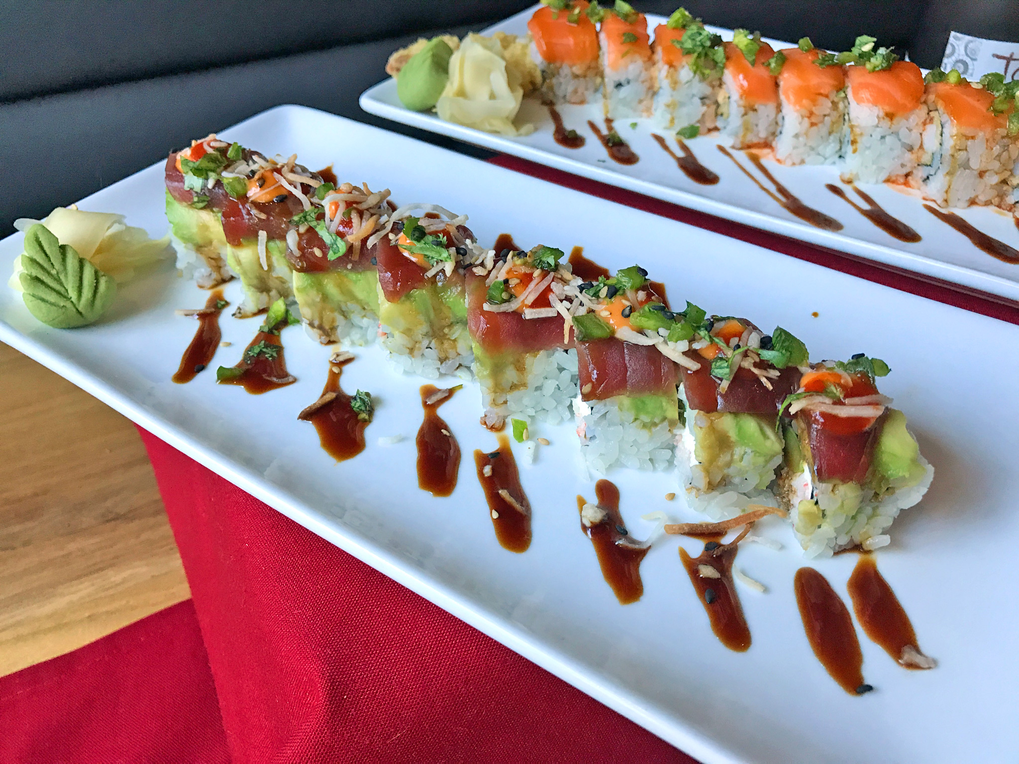 High Roller = snow crab / tuna / cream cheese / coconut flakes / cilantro avocado / eel sauce / spicy mayo