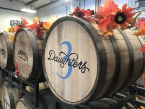 Barrels with the 3D logo in the brewery