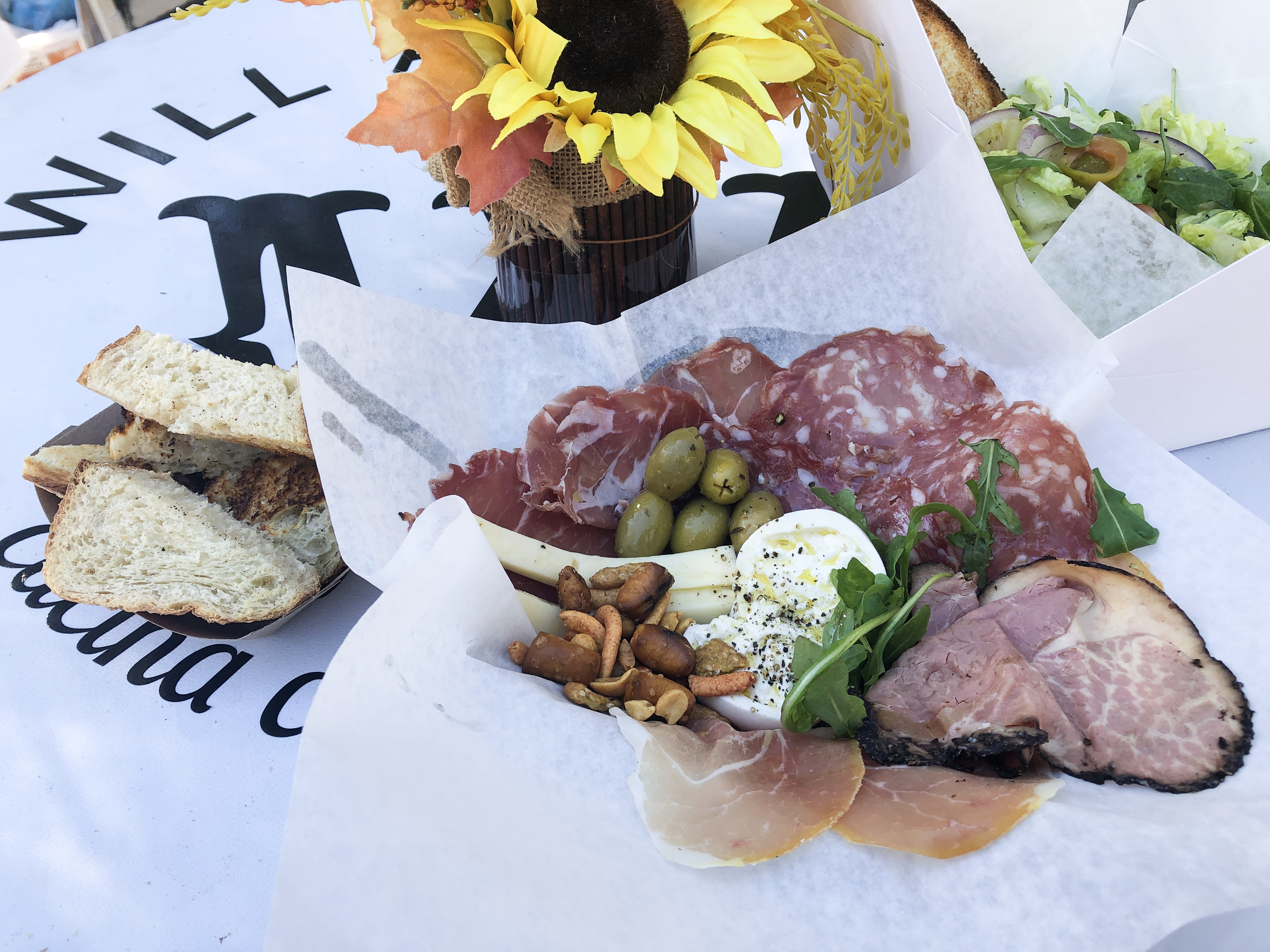 Charcuterie Plate with imported cured meats and cheeses, nuts, honey and toasted crostini