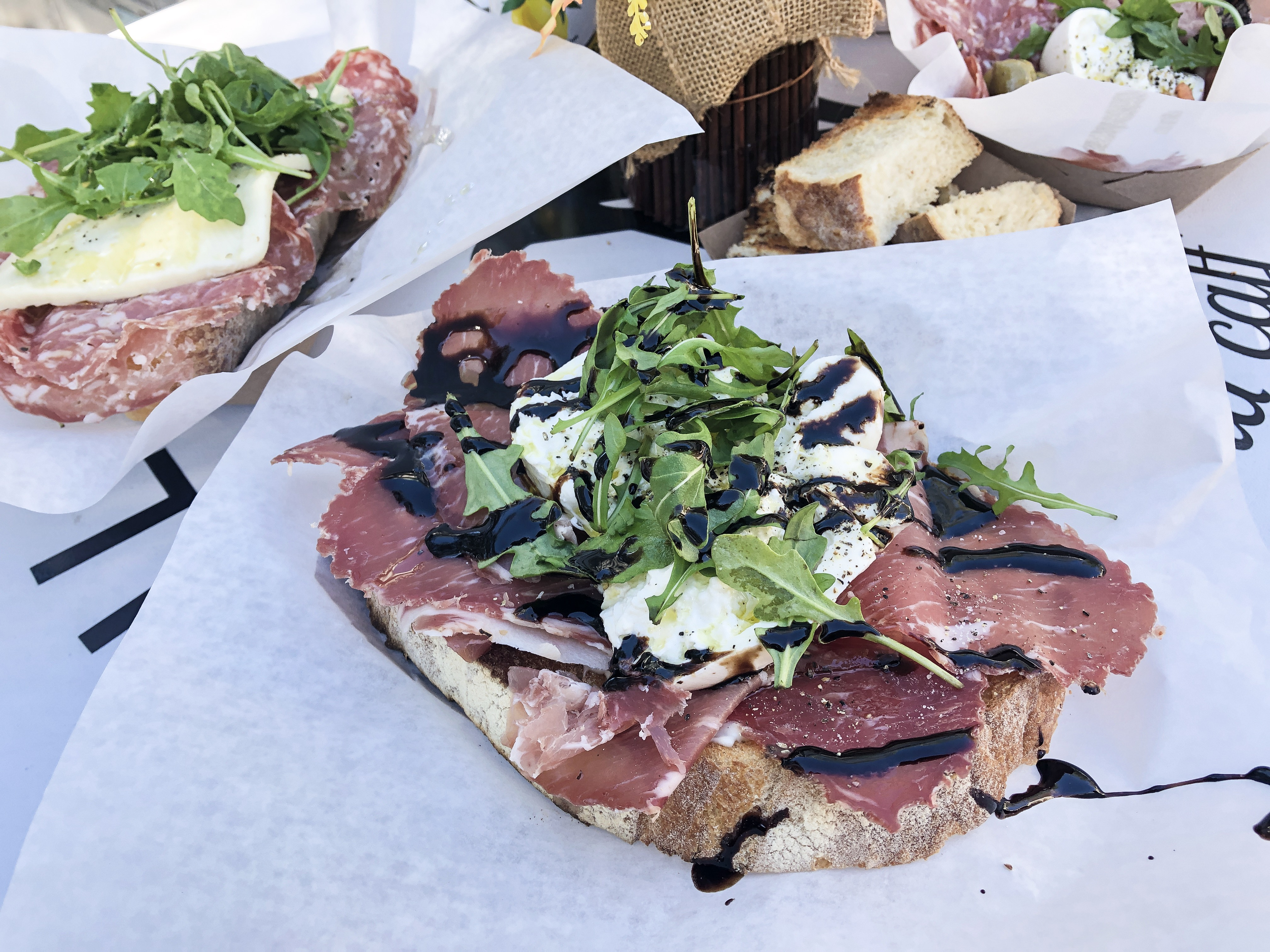 Firenze Love Crostini with imported capicolla, creamy truffle infused burrata cheese, Mayo Arugula and Porcini mushroom glaze