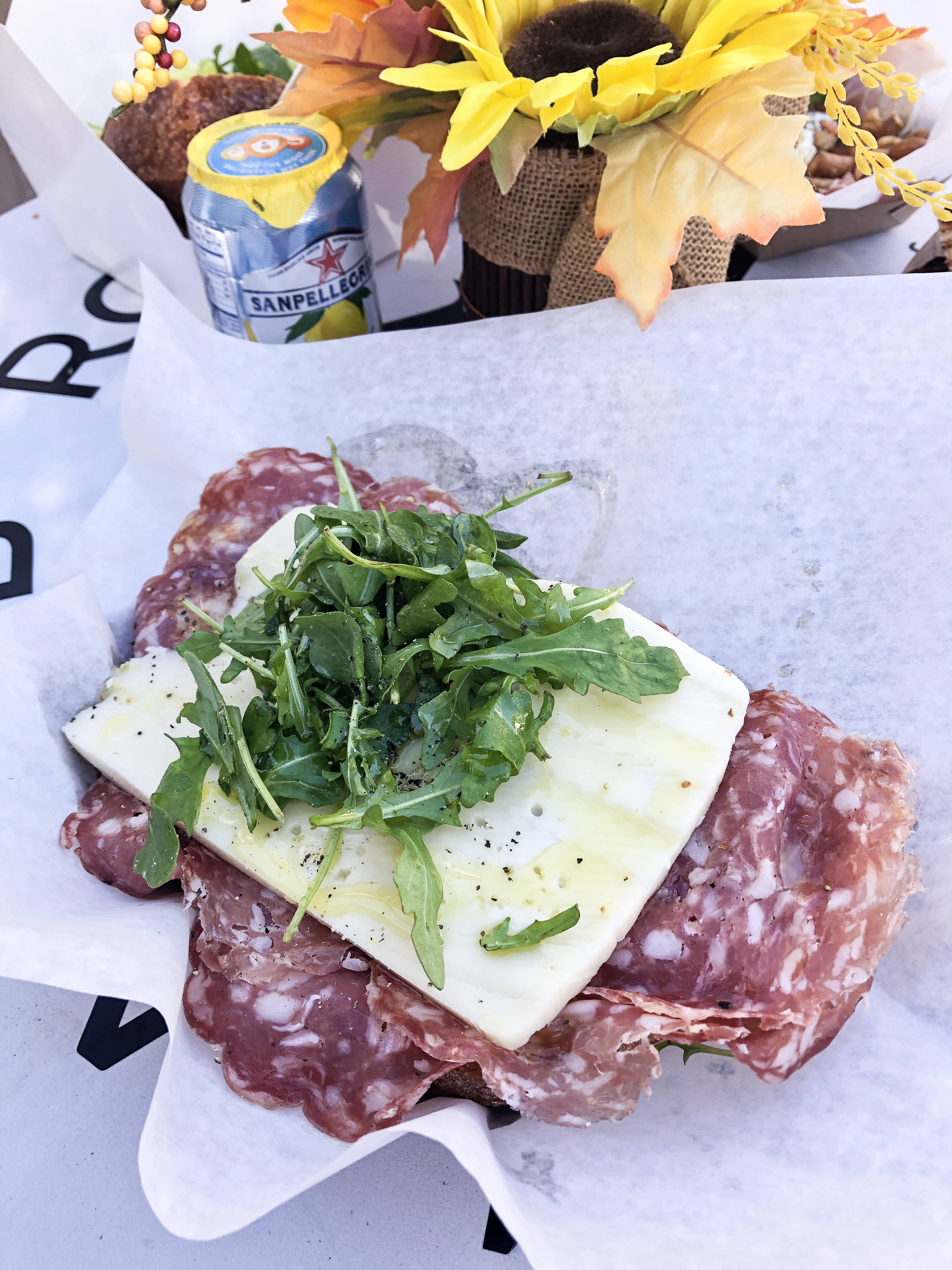 Rustico Crostini Sandwich with imported spicy Calabrese dry sausage, Pecorino cheese, homemade dijonnaise, greens Sicilian sea salt and evoo