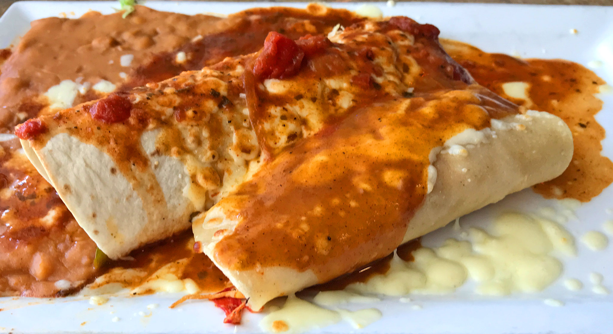 Pork Burrito, Chicken Enchilada, Refried Beans