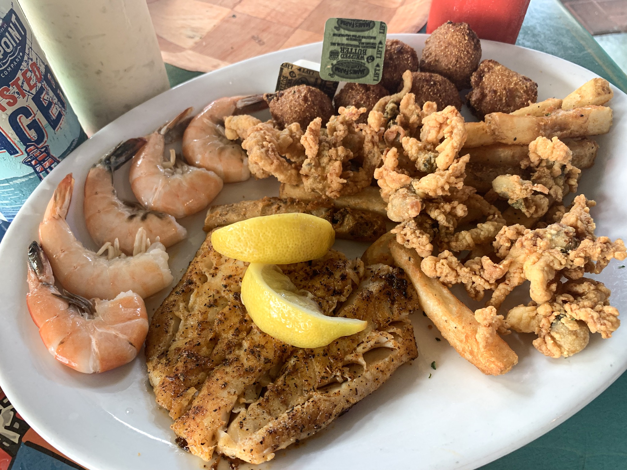 The Seafood Sampler from the Casual Clam with fried Whole Belly Clams, blackened Haddock and Peel n' eat Shrimp