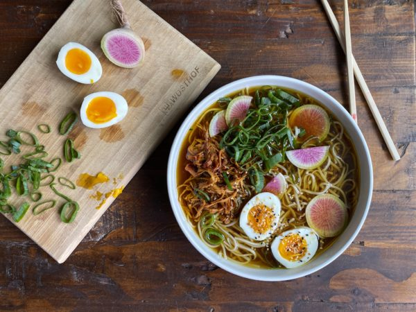 Ramen and sliced eggs and radishes