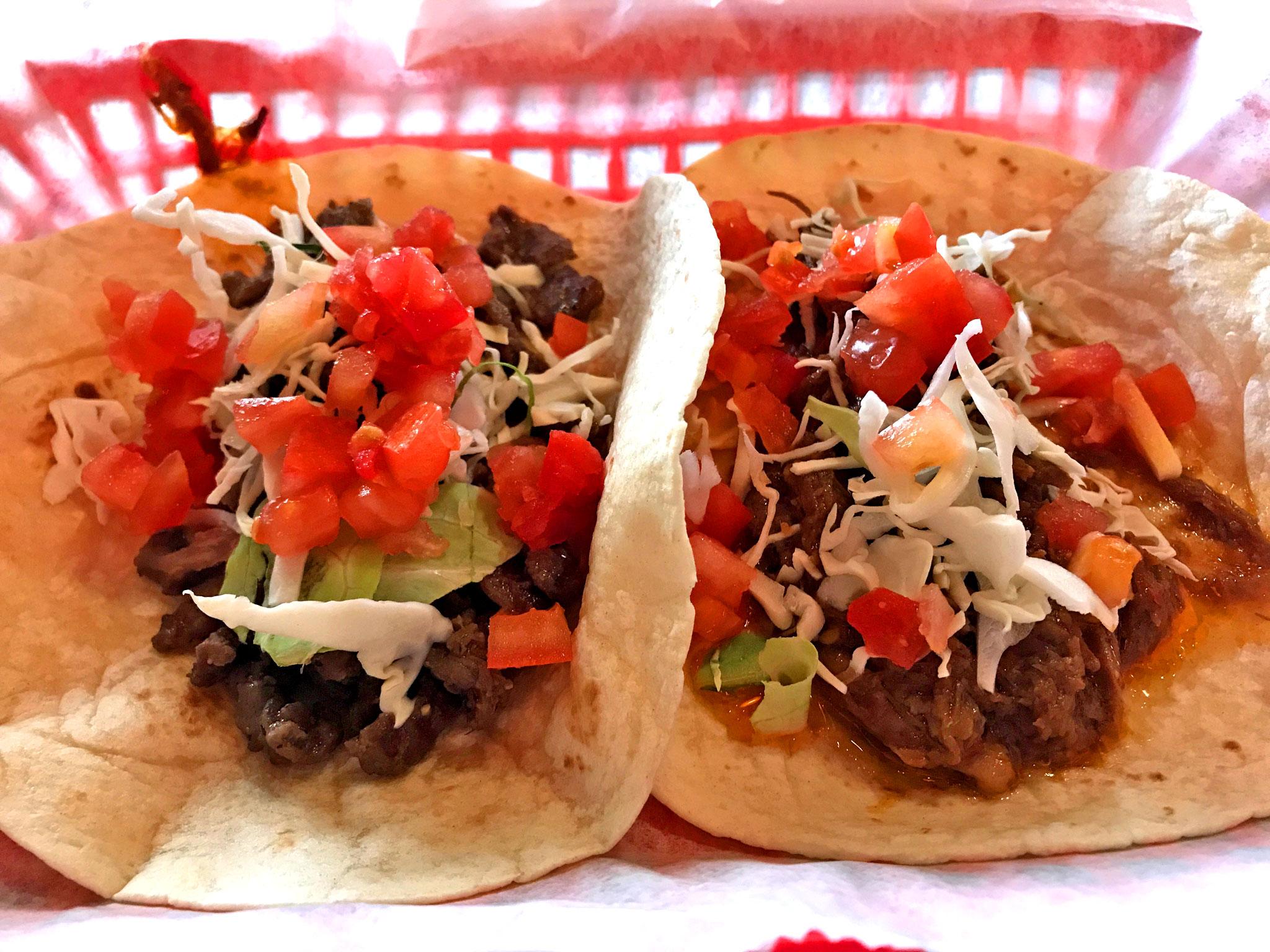 Carne Asada Taco (L), Barbacoa Taco (R)