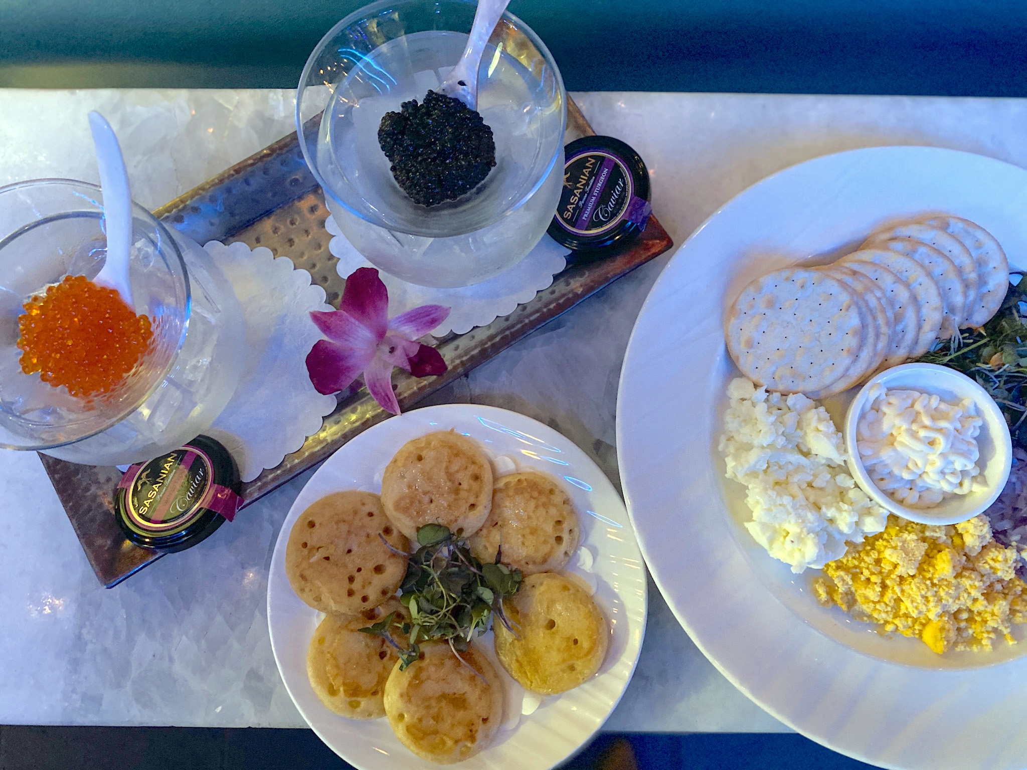 Flute & Dram Overhead of caviar with Russian blinis