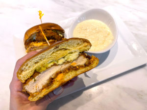 The Chicken Sandwich with Grits at The Dewey