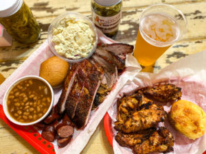 Ribs, wings, sausage, brisket, pulled pork, beans, potato salad and roll at Smoking' J's