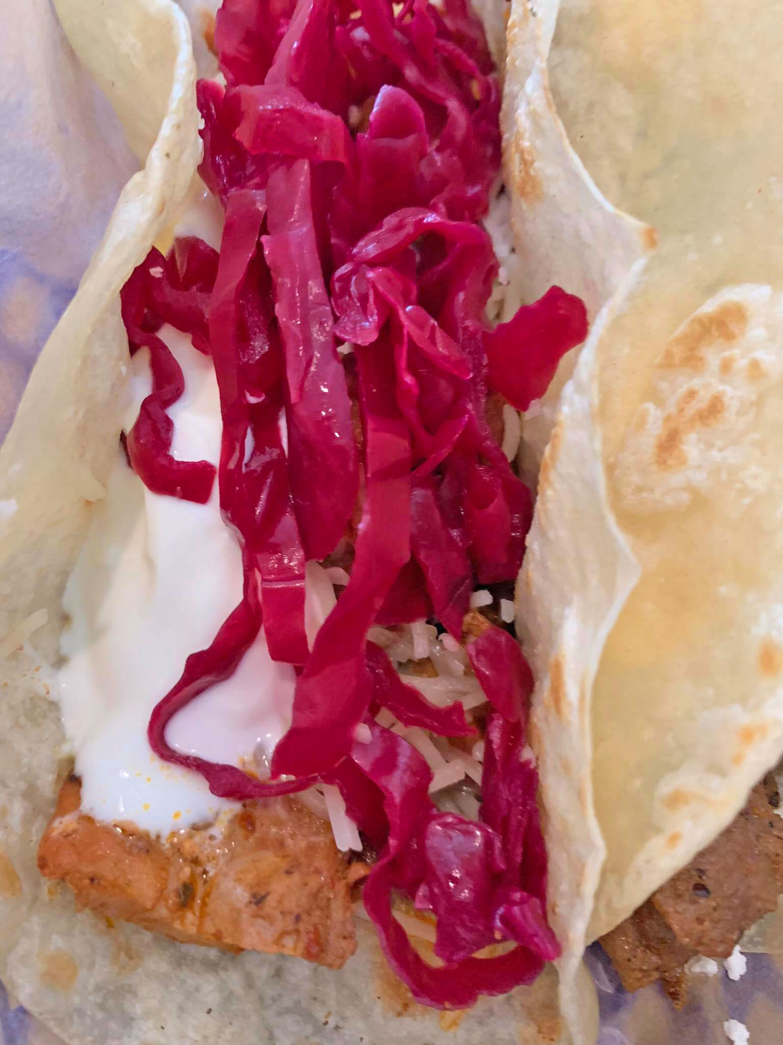 Carne asada with sour cream, jack cheese and a pickled lime cabbage