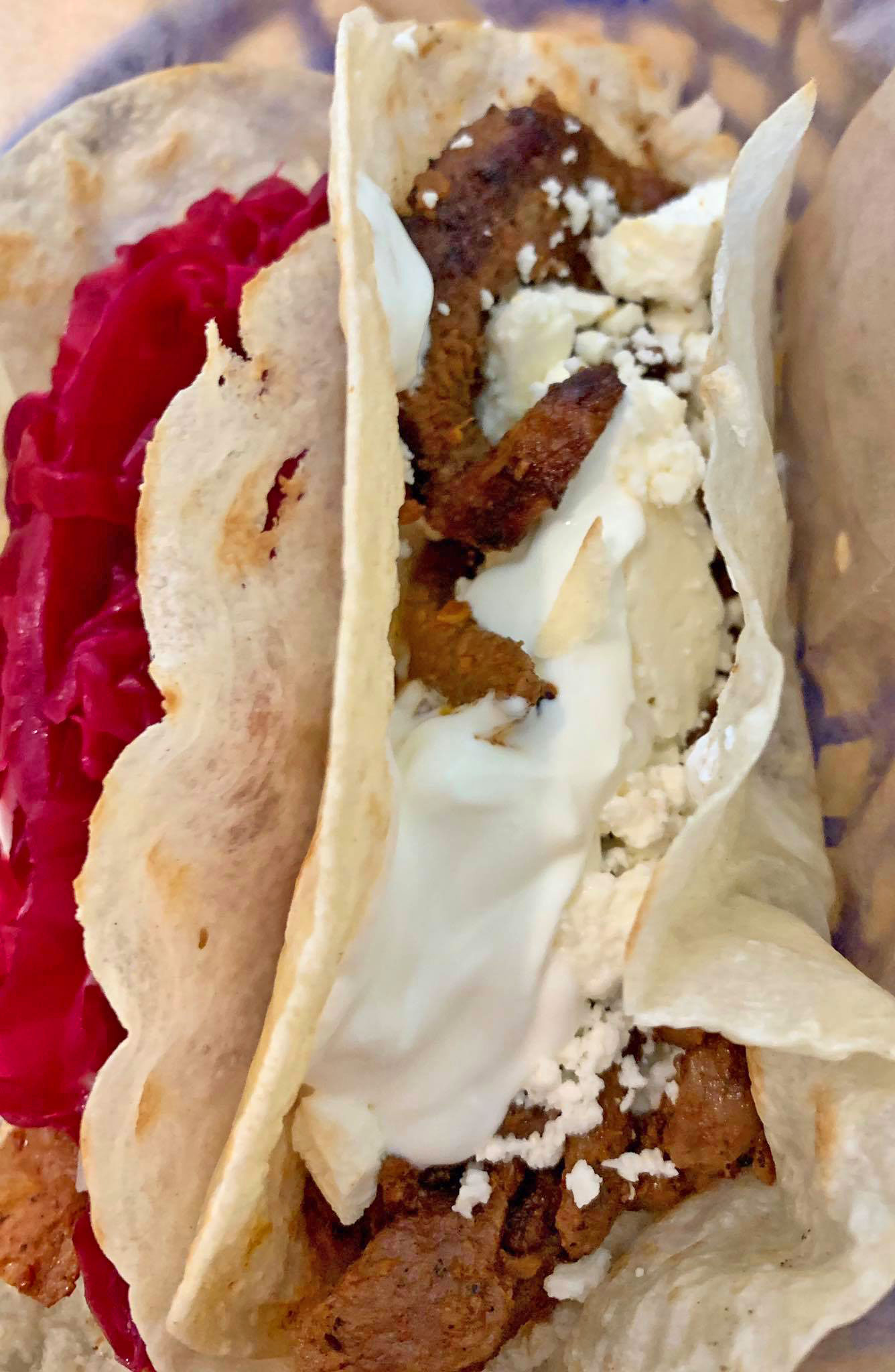 On the right is the al Pastor with feta and sour cream