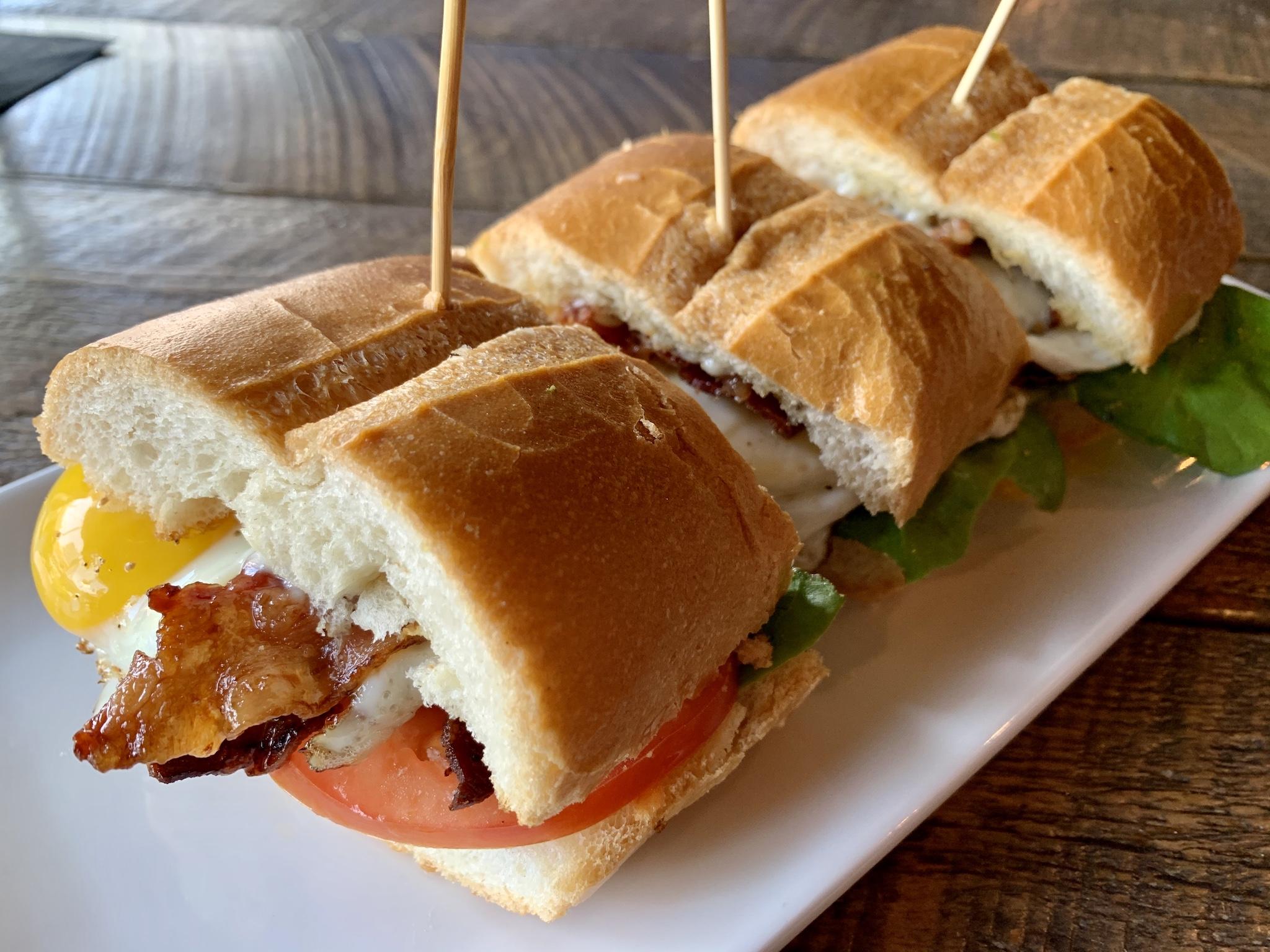 BLT Sliders - Cuban bread, gem lettuce, candied bacon, tomato, egg, avocado and basil garlic aioli