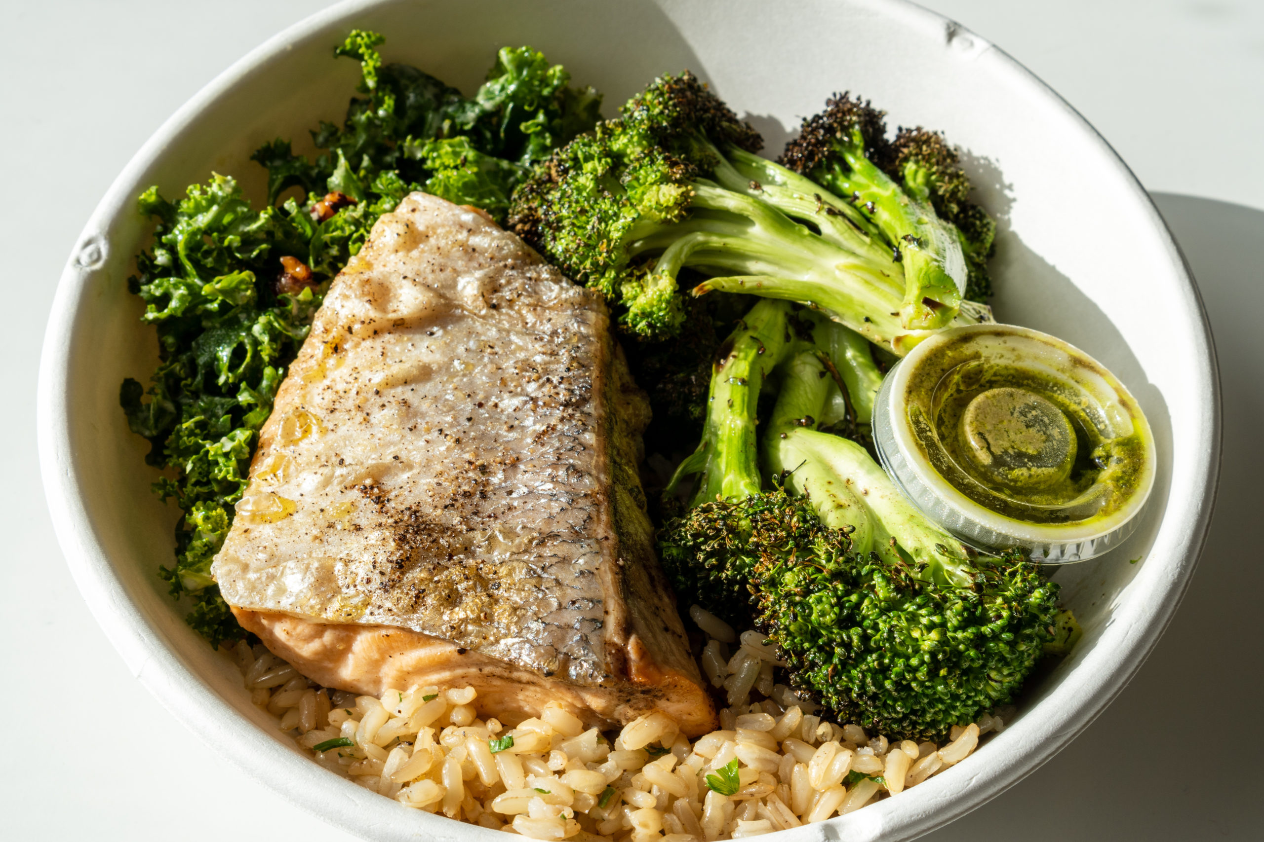Make Your Own Bowl- Gulf of Maine Salmon, pecan kale caesar, charred broccoli with lemon, brown rice with parsley