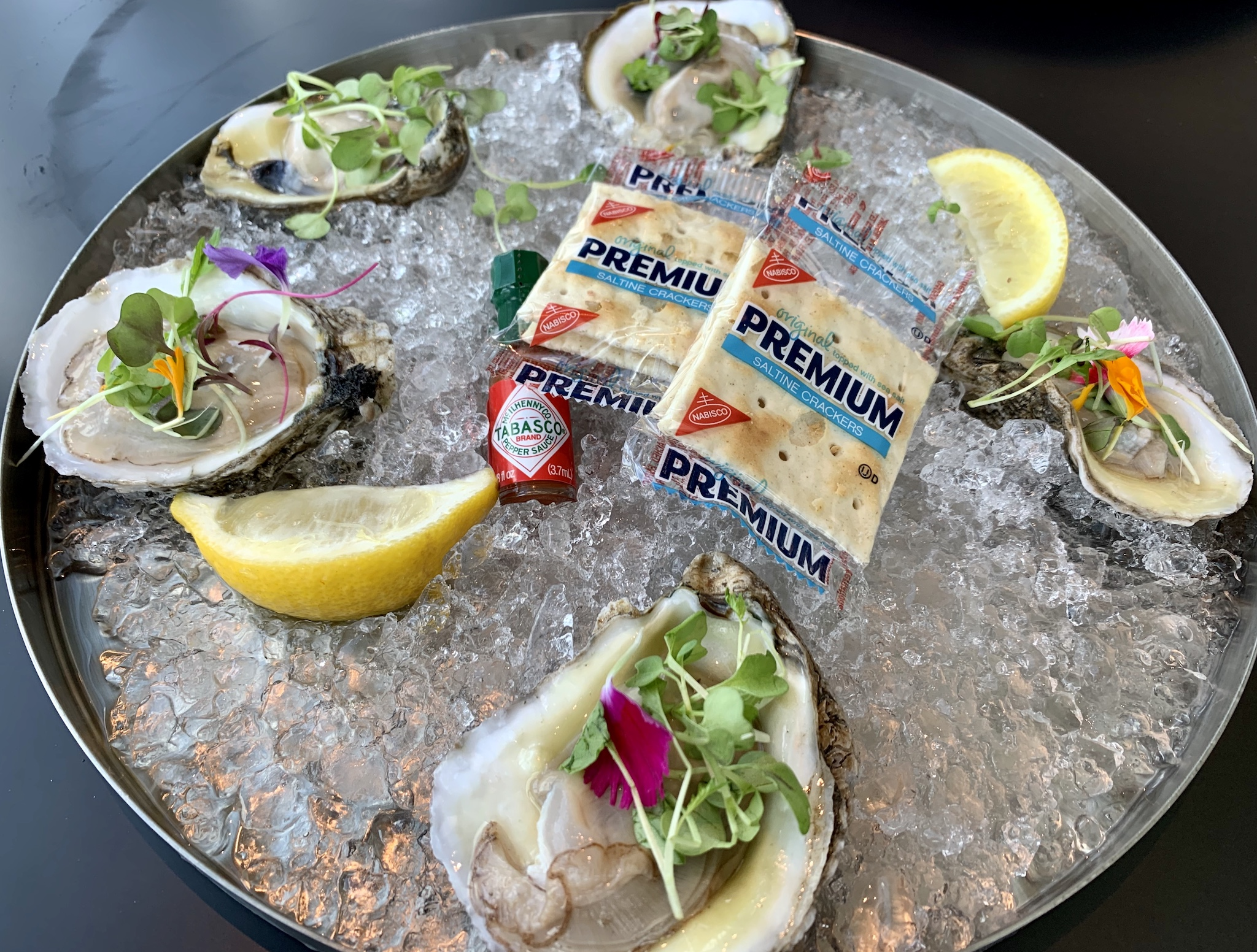 Teak Featured Shucked Oyster - saltines, mini Tabasco, lemons, classic cocktail sauce