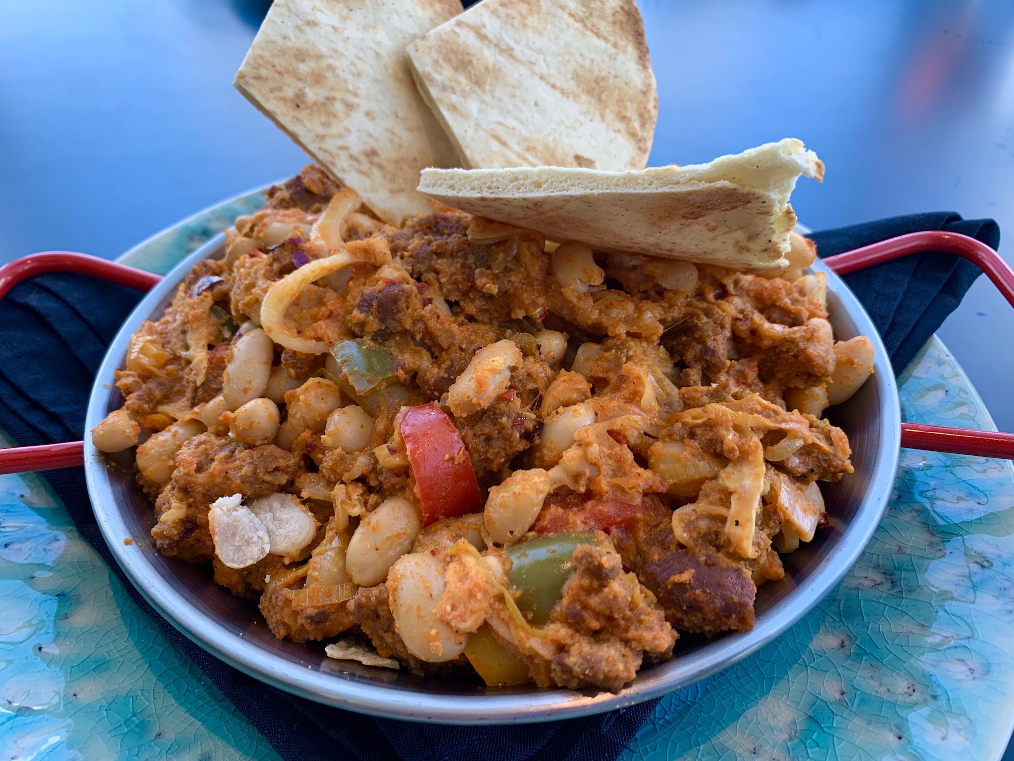 Teak at the St Pete Pier - Spanish Chorizo & White Bean Skillet - garlic & peppers, spanish sausage, cannellini beans, fennel, leeks and romesco. Served with pita.