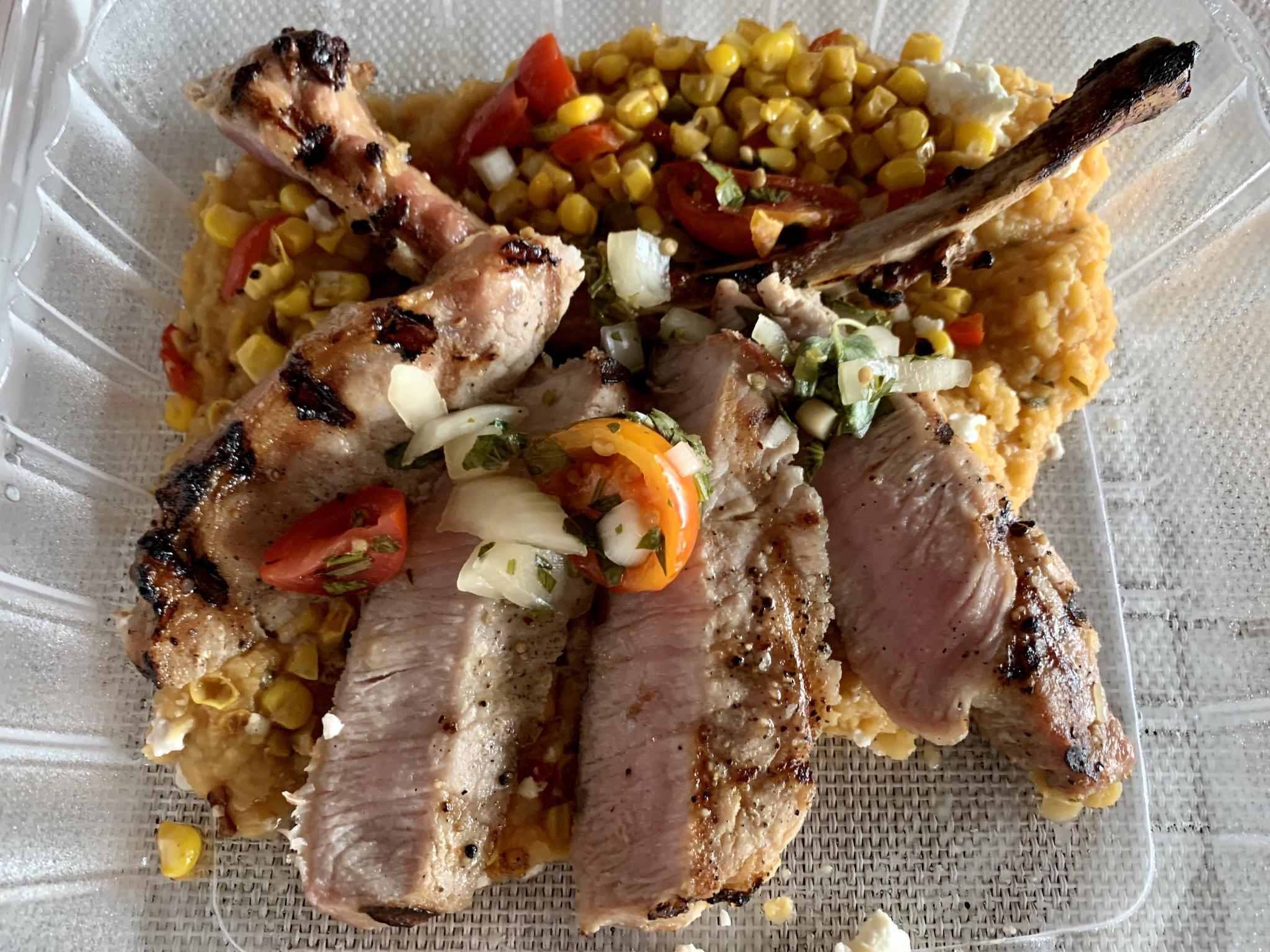To-go Order - Pork Tomahawk with chiptle refried lentils, street corn succotash, Fresno yellow grape tomato chimichurri