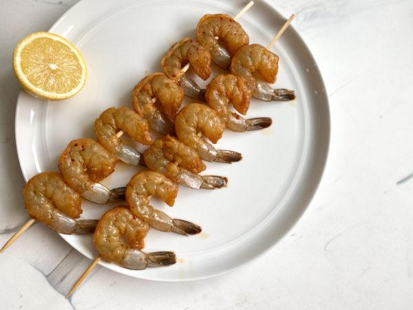 Threaded shrimp before hitting the grill