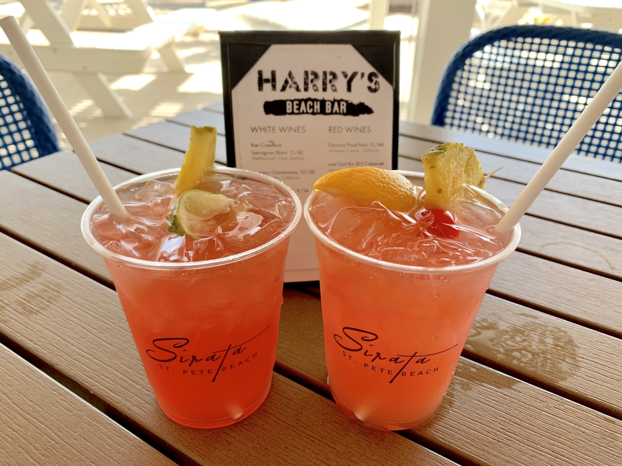 Harry's Beach Bar - Sea Breeze - Tito's, grapefruit juice, cranberry and lime; Harry's Sunset - Absolut Mandarin, grapefruit, lemonade and grenadine