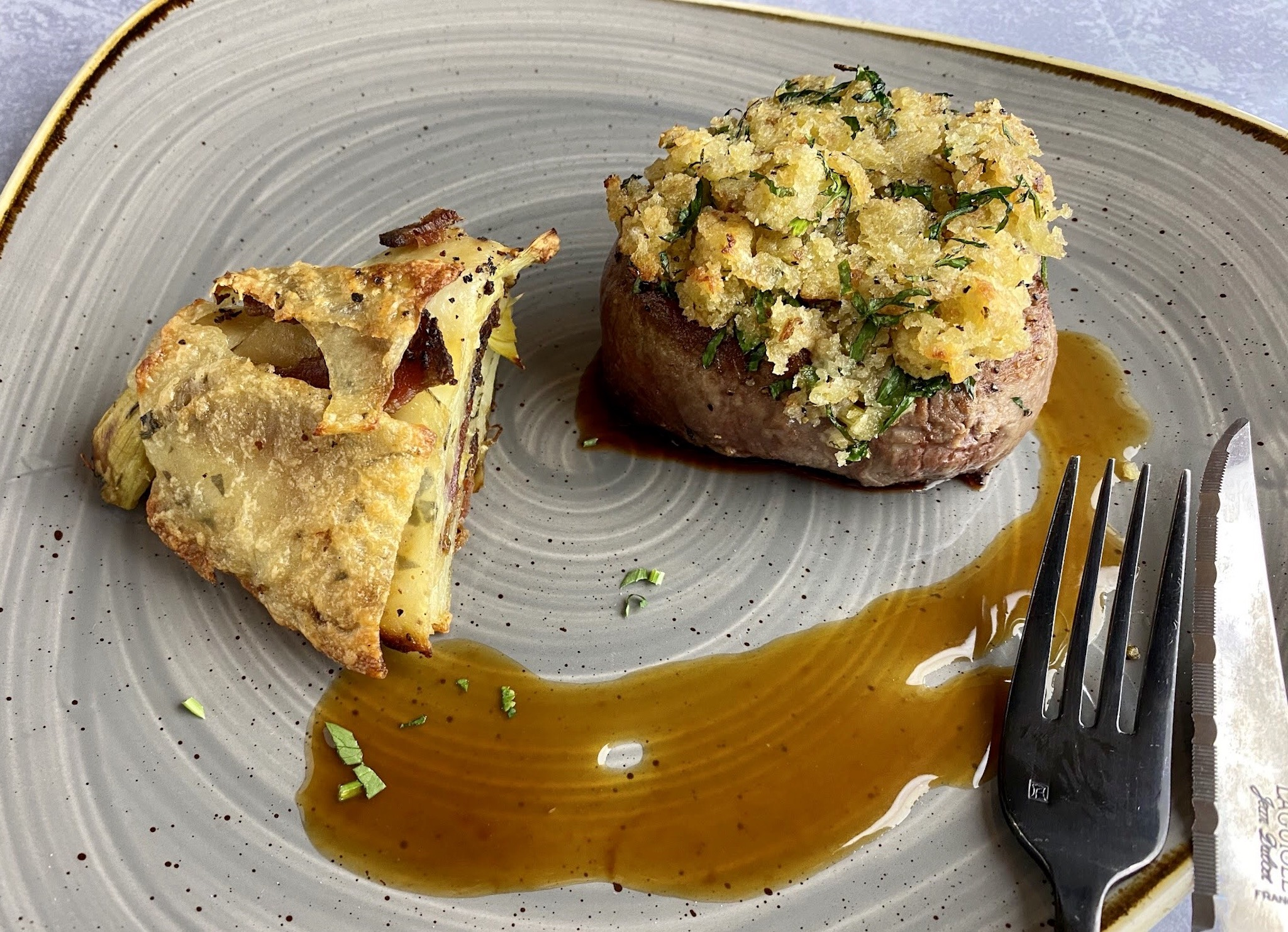 USDA Prime 8oz Firlet Mignon with an herbed breadcrumb crust, artichoke bacon and potato torte with demi glaze