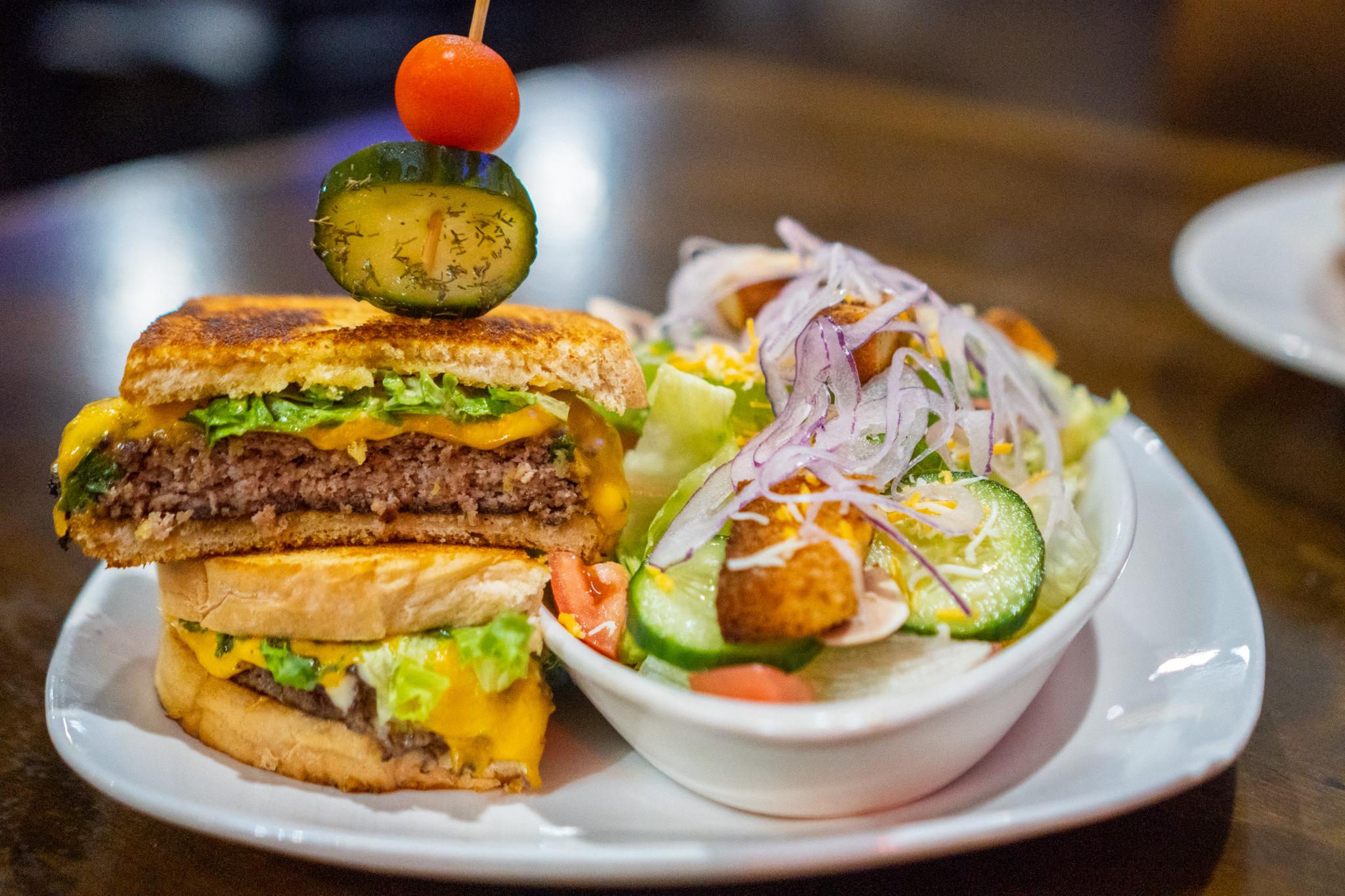 The Wheelhouse Boopie's Burger Melt and Side Caesar Salad