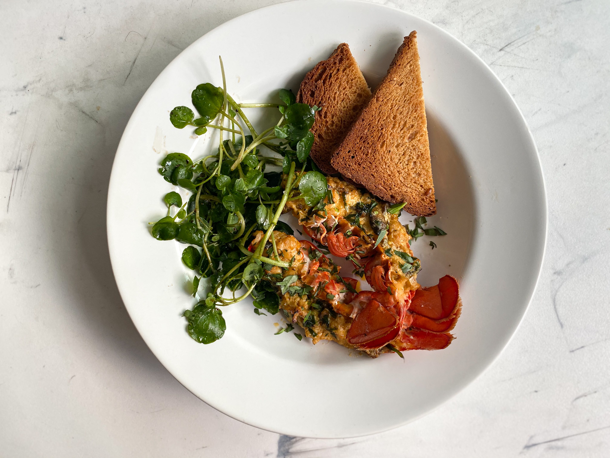 Lobster Thermidor served with toasted Dave's Killer Bread and a Watercress Salad