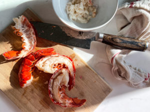 Removing the lobster meat from the tails