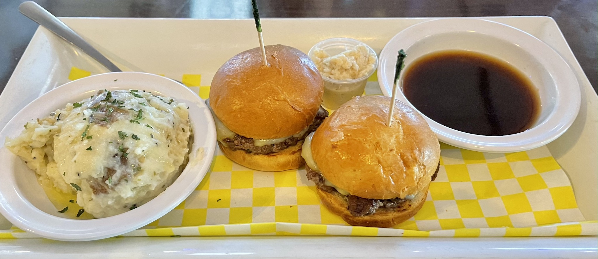 Shrimpys Prime Rib Sliders served with horseradish mash and bone marrow au jus