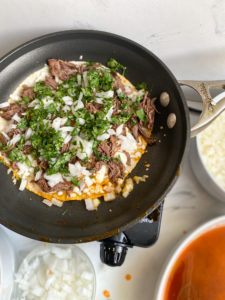 Meat, onions and cilantro added to the skillet