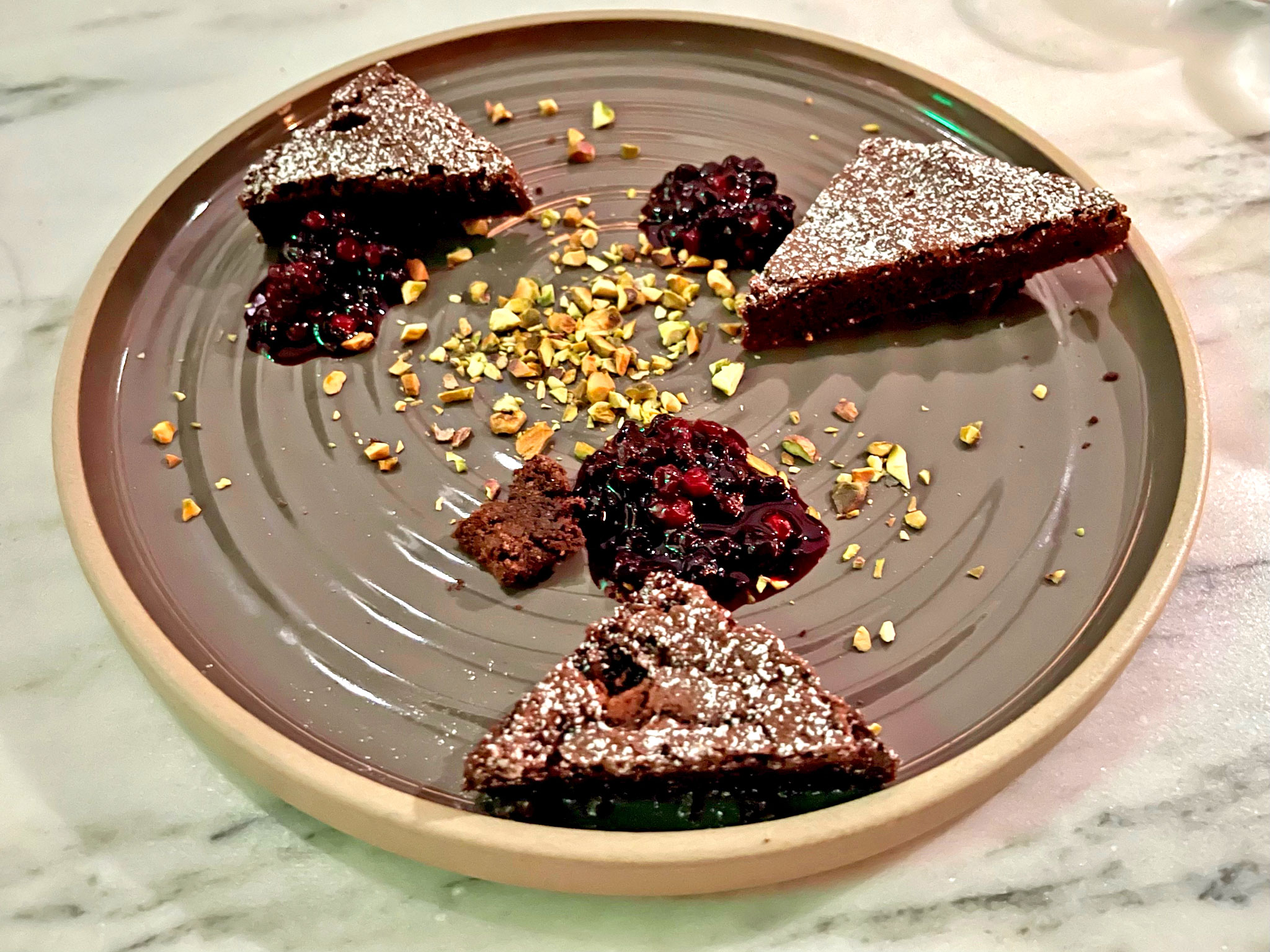 Kladdkaka Cake with Wild Berry Compote and Toasted Pistachios