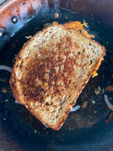 Browning the second side of the grilled cheese