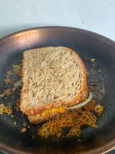 Second piece of bread with red pepper jelly to finish the sandwich